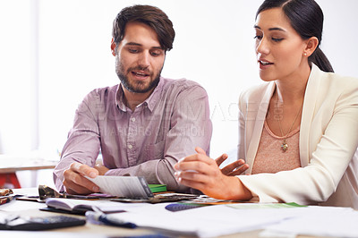 Buy stock photo Young creative professionals talking in an office