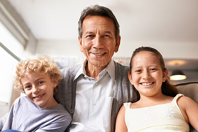Buy stock photo Portrait of a grandfather standing between his grandchildren