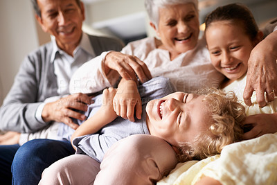 Buy stock photo Shot of grandparents and their two grandchildren spending time together