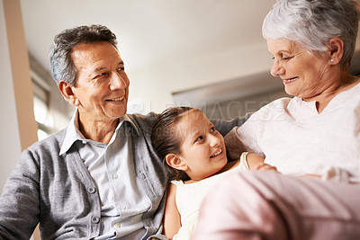 Buy stock photo Shot of a little girl sitting with her grandparents at home