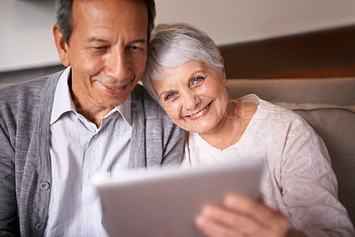 Buy stock photo A senior couple sitting with a digital at home
