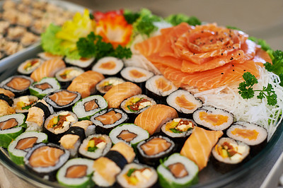 Buy stock photo A selection of sushi arranged on a platter