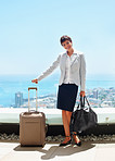 A businesswoman with luggage and bags ready to go on a business tour