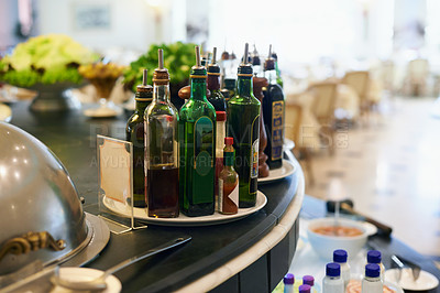 Buy stock photo A collection of oilive oil and balsamic vinegar on the counter in a restuarant
