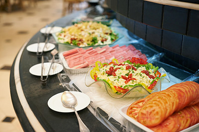 Buy stock photo A selection of dishes on a rotating buffet counter