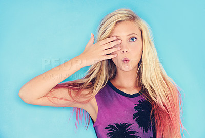 Buy stock photo Cropped shot of an attractive and trendy young woman against a blue background