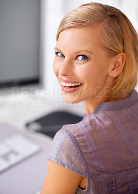 Buy stock photo Portrait of a beautiful young woman sitting at her desk in an office