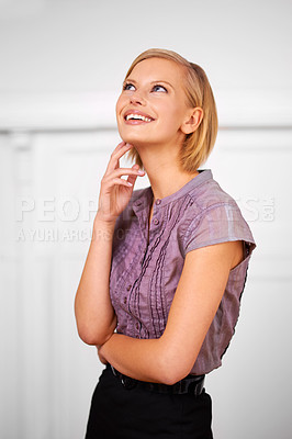Buy stock photo Shot of a beautiful smiling young woman dressed for the office