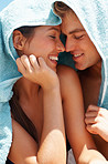 Young couple covering their head with a towel
