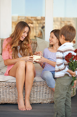 Buy stock photo Shot of a mother and her two children holding gifts for mother's day
