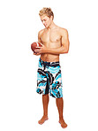Handsome young guy in shorts with a rugby ball