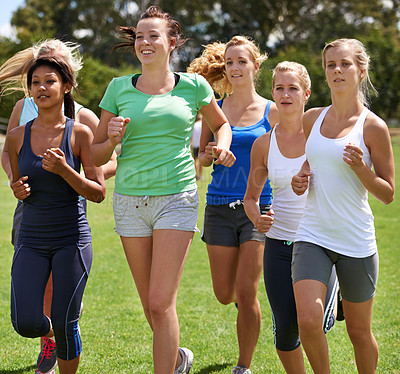 Buy stock photo Cropped shot of young people running outdoors