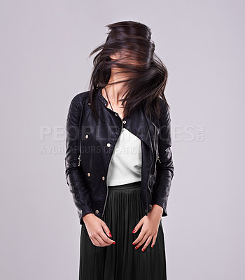 Buy stock photo Shot of a woman in studio dressed in fashionable attire