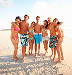 Full length image of friends standing together at the beach