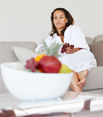 Buy stock photo Young woman in a bath robe having fruits at home