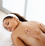 Pampered young female getting a body massage