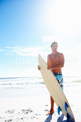 Buy stock photo Full length image of a handsome man standing with a surf board