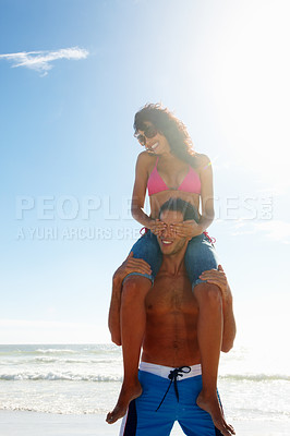 Buy stock photo Happy female sitting on friends shoulders by the sea shore