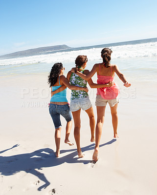 Buy stock photo Rear view of pretty teenagers playing on the sea shore