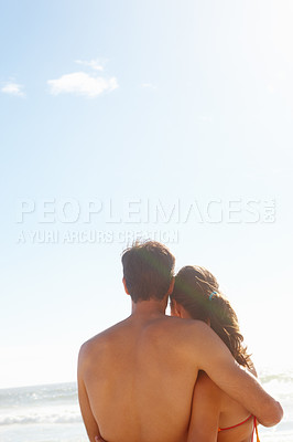 Buy stock photo Rear view of a young man holding his girlfriend at the sea shore