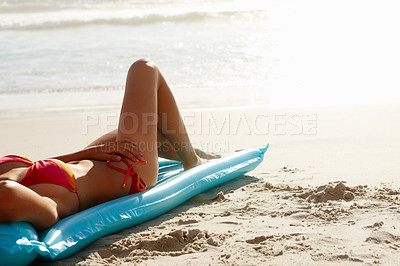 Buy stock photo Torso of relaxed young lady in red bikini at the beach