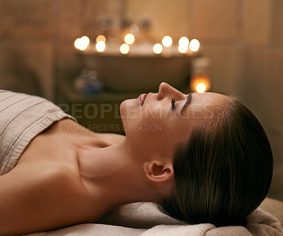 Buy stock photo A young woman lying with her eyes closed on a massage bed