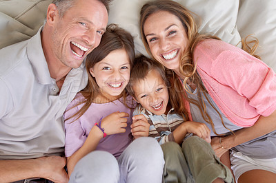 Buy stock photo Shot of a happy young family playing together