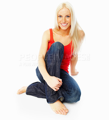 Buy stock photo An elegant young woman sitting with her legs crossed, isolated over white background