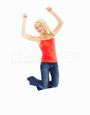 Buy stock photo Young sexy female jumping of joy isolated against white background