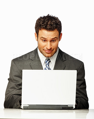 Buy stock photo Portrait of a successful business man working on a laptop, isolated against white