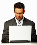 Successful business man working on a laptop over white background