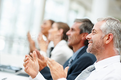 Buy stock photo Happy business team applauding together