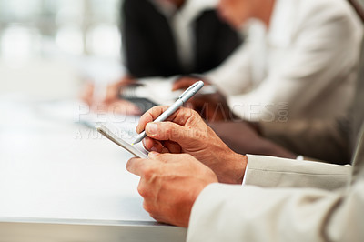 Buy stock photo Closeup portrait of a businessman hands writing on a notepad
