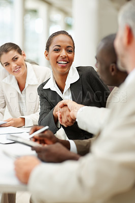 Buy stock photo Cute business woman being congratulated for her achievements