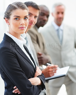 Buy stock photo Portrait of a lovely business woman posing with her staff standing along with her