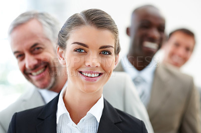 Buy stock photo Blur image of a pretty business woman in front with her staff standing behind