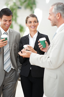 Buy stock photo Group of sophisticated happy business people discussing business issues
