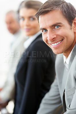 Buy stock photo A happy young business man smiling confidently
