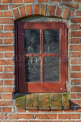 Buy stock photo A close-up image of a rustic window frame on a brick house