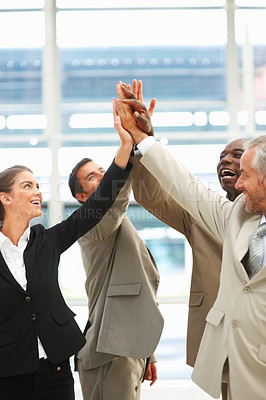 Buy stock photo Portrait of a successful business team raised their hands raised together in agreement