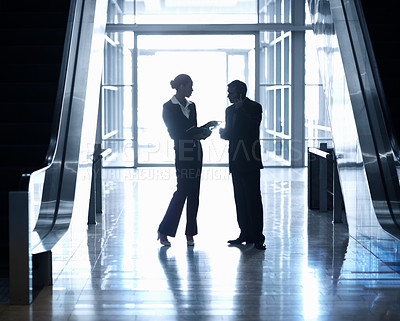 Buy stock photo Silhouette image of a business man and woman standing together