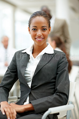 Buy stock photo Portrait of a professional African American business woman sitting on a chair