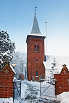 A photo of a Danish Church in winter