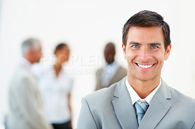 Buy stock photo Portrait of a successful business man with colleagues at the back