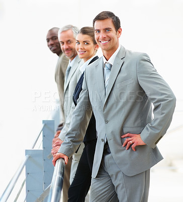 Buy stock photo Portrait of successful business partners standing in a line and smiling confidently