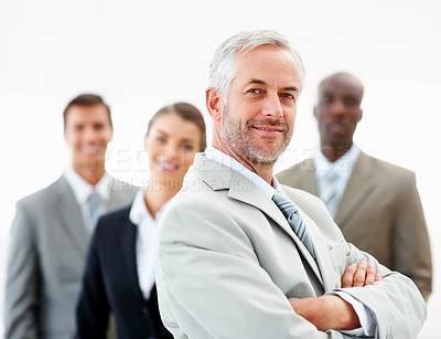Buy stock photo Business man with hands folded and team at the back, on white