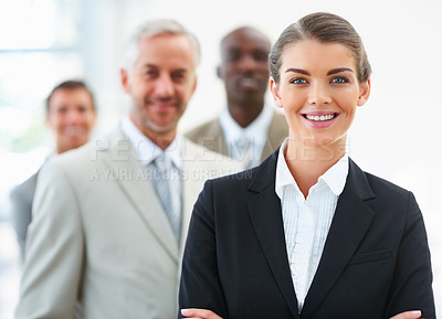 Buy stock photo Portrait of a charming business woman with team at the back