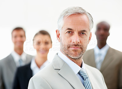 Buy stock photo Successful business man with team at the back on white background