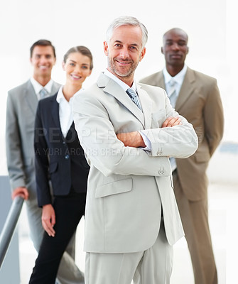 Buy stock photo Senior business man with hands folded and colleagues at the back, on white