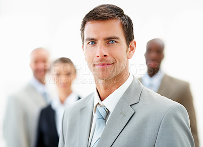 Buy stock photo Blur image of a handsome business man with his colleagues over background
